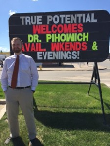 Dr Pihowich in front of Welcome Sign