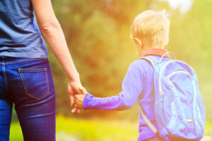 immune support photo -mom with son on way to school